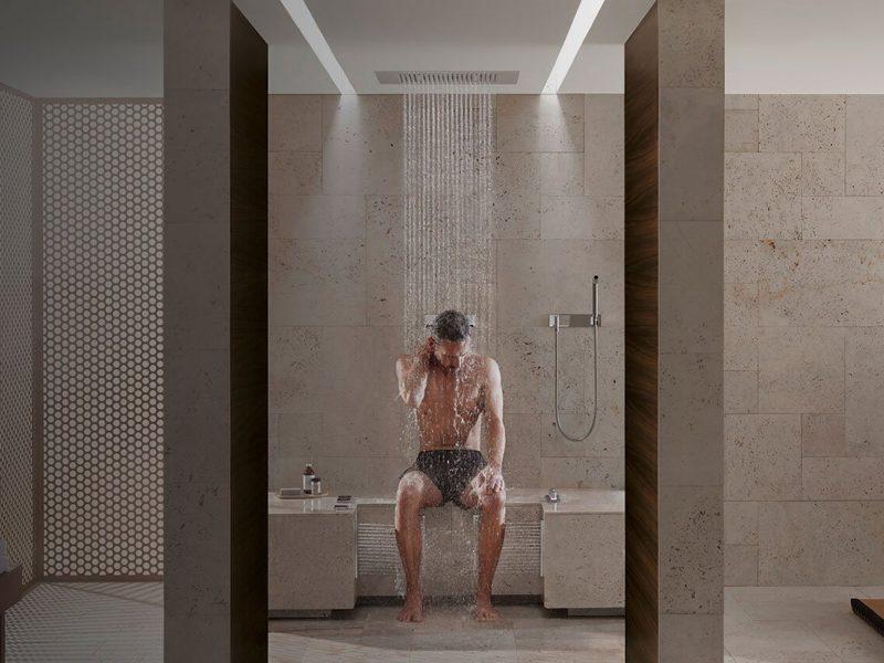 Spa in casa impermeabilizzato seminterrato con doccia, hammam e momento di relax seduto